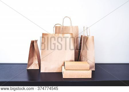 Craft Paper Eco-friendly  Bags And Boxes For Shopping Or Lunch Set. Concept Of Eco-friendly Consumpt