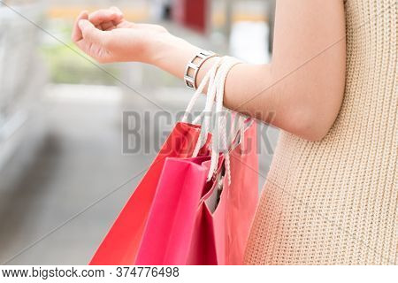 Close-up Woman Carrying A Lot Of Colourful Shopping Bags Enjoy Shopping In Holidays. Have A Copy Spa