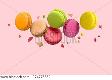French Macaroons Falls Mixed With Crumbs On Pink Background.