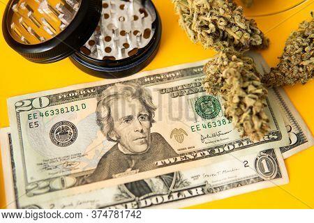 Money Weed. Marijuana Weed Bud And Grinder. Marijuana Bud And Banknotes Of Dollars. Indica Medical H
