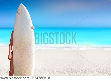 Girl Holding A Surfboard In A White Sand Tropical Beach