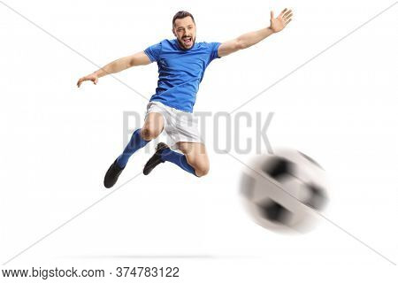 Footballer performing a volley with a soccer ball isolated on white background