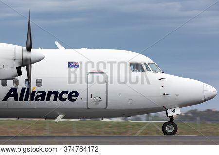 Avalon, Australia - February 28, 2015: Alliance Airlines Fokker 50 Regional Airliner Aircraft Taxiin