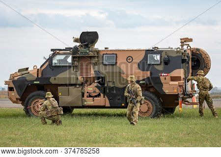 Avalon, Australia - February 27, 2015: Australian Army Soldiers With A Bushmaster Armoured Personnel