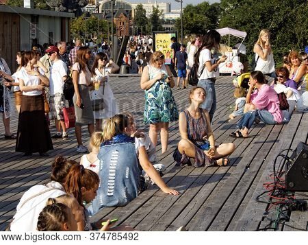 Moscow, Russia, Aug 12, 2017: Viewer Sitting On The Dais In The City Park