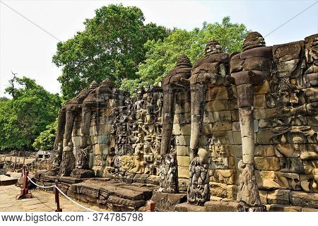 Elephant Terrace At Angkor Temple. Cambodia. The Stone Pedestal Is Decorated With Carvings, Bas-reli