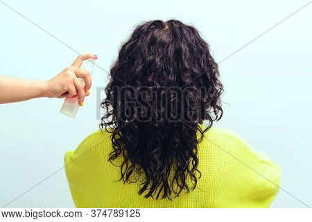 Hairstyle With Curly Hair. Brunette Girl With Long Curly Hair, Back View. Beautiful Woman With Wavy