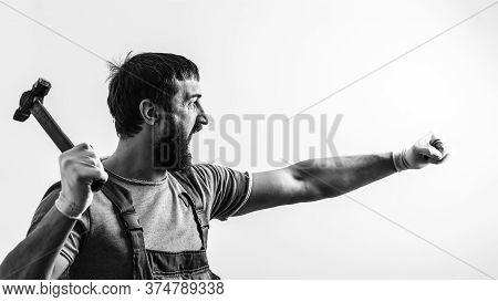 Screaming Foreman Holding Hammer. Brutal Man Hammering. Construction Work. Bearded Builder Working W