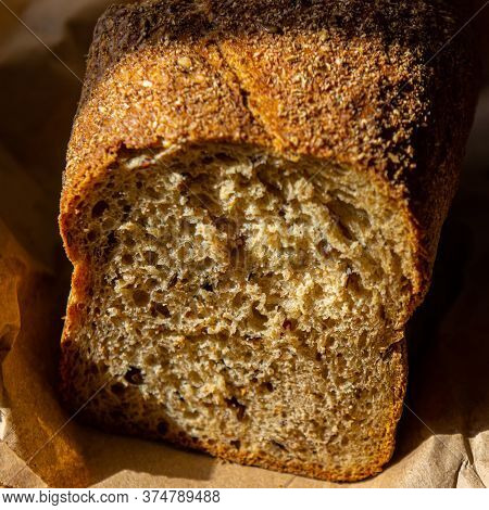 Rustic Bread In Paper Packaging. Summer Season.