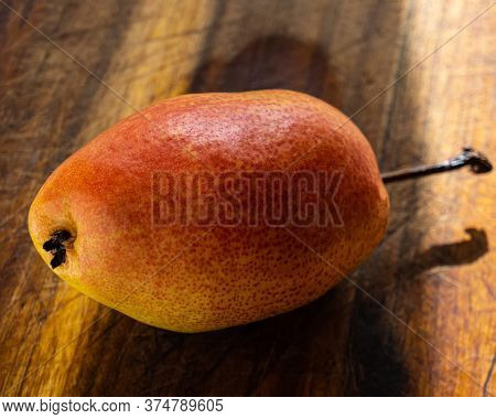 A Pear Lies On An Oak Board. Summer Season.