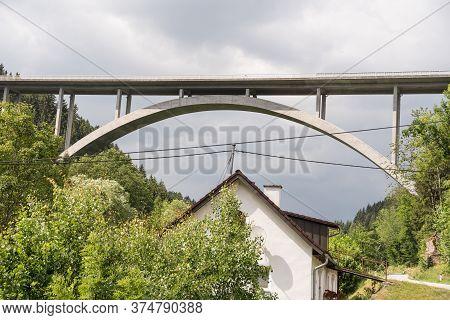 Stable Arch Bridge In A Rural Landscape - Austria