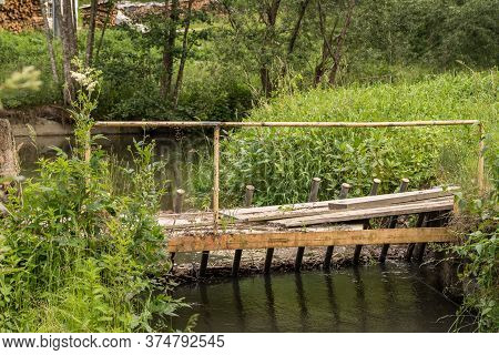Desolate Wooden Bridge Over A Stream - Desolate Bridge In The Country