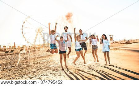 Happy Friends Group Having Fun At Ferris Wheel Seaside - Summer Vacations Friendship Concept With Mi