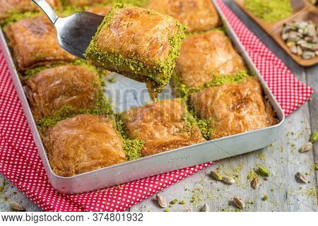 Traditional Turkish Dessert Baklava In Tray On Wooden Table
