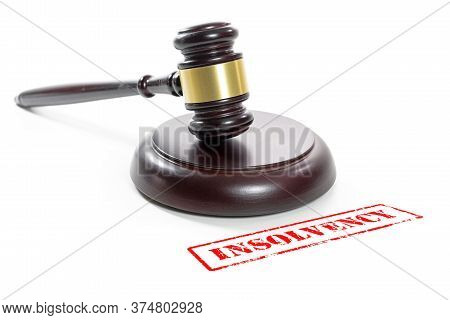 Judge Gavel And A Red Stamp With The Word Insolvency, Companies Are Going Bankrupt Due To The Corona