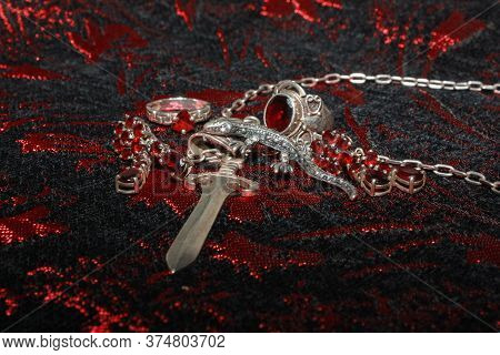 Silver Pendant In The Shape Of A Sword On An Anchor Chain, Silver Set Of Earrings And Rings With Nat