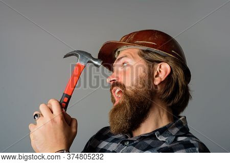 Repairment. Mechanical Worker. Worker With Hammer. Builder In Hardhat. Portrait Of Bearded Workman.