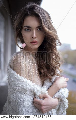 Close Up Frontal Portrait Of A Girl With Long Hair, Looks At The Camera, With Make Up, Being On The