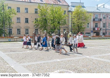 Lublin, Poland - June 11, 2020: People Going Back To Church After Catholic Procession On Feast Of Co