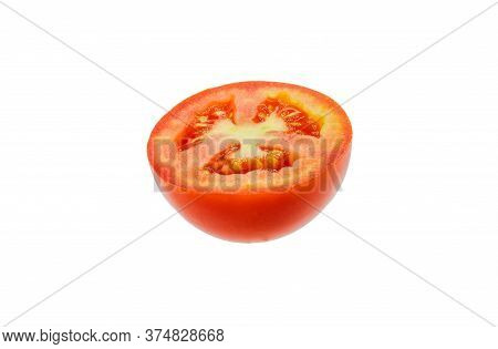 A Half Tomato Isolated On White. Close Up