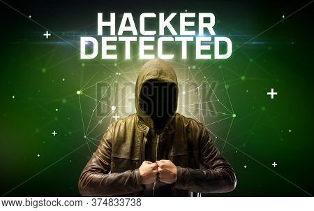 Mysterious hacker with HACKER DETECTED inscription, online attack concept inscription, online security concept