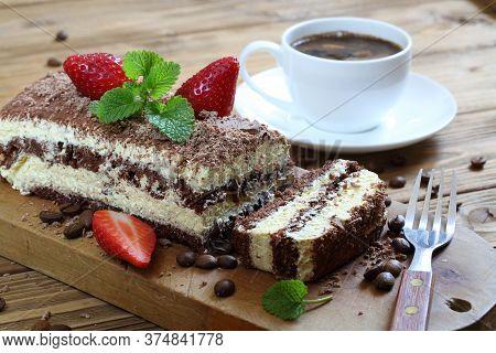 Tiramisu. Tiramisu Cake With Coffee. Tiramisu With Strawberries And Mint