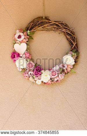 Beautiful Floral Wreath, Home Ornament Hangs On Wall.