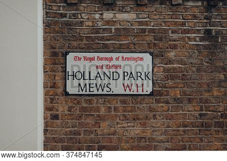 London, Uk - June 20, 2020: Holland Park Mews Street Name Sign On A Wall In The Royal Borough Of Ken