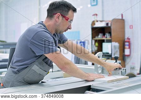A Man Works In The Assembly Shop On A Circular Saw, Neglecting Safety Requirements