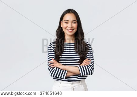 Lifestyle, People Emotions And Casual Concept. Confident Nice Smiling Asian Woman Cross Arms Chest C