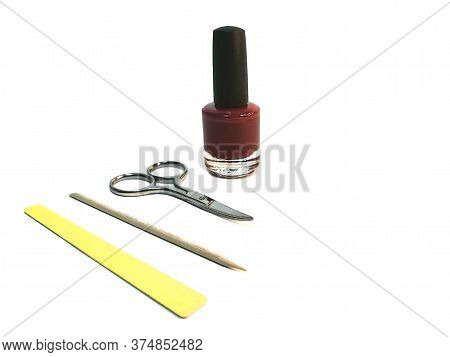 Set For Self-care Of Nails: Manicure Scissors, A Cuticle Stick, Nail Polish And A Set Of Files. The
