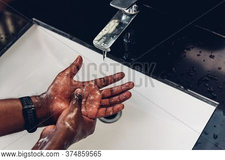 Closeup Washing Black Man Hands Rubbing With Soap And Water In Sinks To Prevent Outbreak Coronavirus