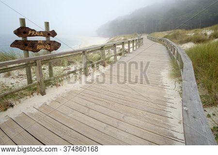 Rodas Beach In The Cíes Island Galicia Spain, Sign Translation
