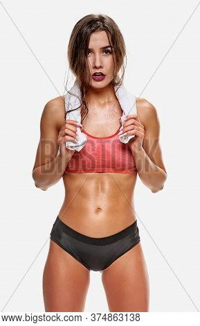 Muscular Fit Tired Woman Taking Break After Exercise