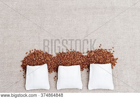 Cereal Buckwheat Close Up With Copy Space. Full Sack Bags. Buckwheat Croup On Coarse Cloth. Healthy