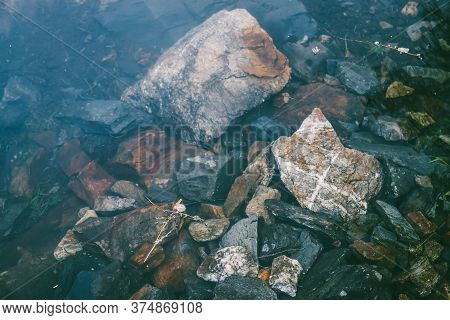 Nature Background With Many Stones On Bottom Of Mountain Lake With Clear Water. Natural Texture Of S