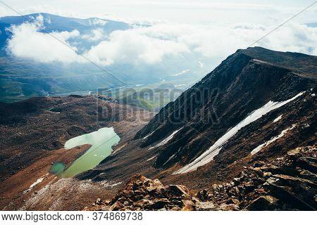 Most Beautiful Glacial Lake Of Acid Green Color. Emerald Mountain Lake Near Big Black Rocky Mountain