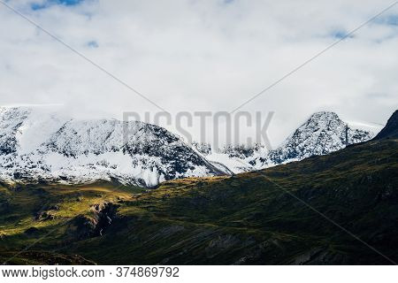 Wonderful View To Great Mountains With Snow On Tops And Glaciers. Dramatic Landscape With Snowy Moun