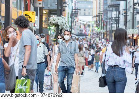 Andorra La Vella, Andorra : 2020 July 06 : People Walk In The Comercial Street Named Meritxell After