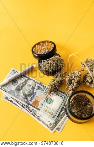 Money Weed. Cannabis In Economics. Joint Weed. Sativa Thc Cbd. Marijuana Weed Bud And Grinder.