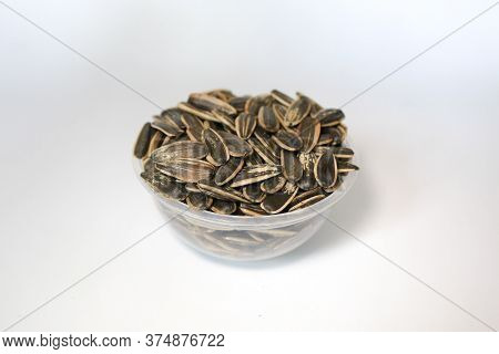 Bowl Of Sunflower Seeds Isolated On White Background.