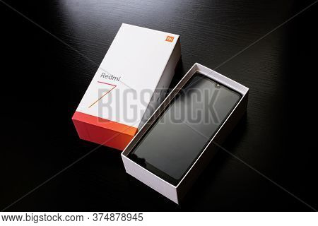Belarus, Novopolotsk - July 04, 2020: Phone In Packing Box Xiaomi Redmi 7