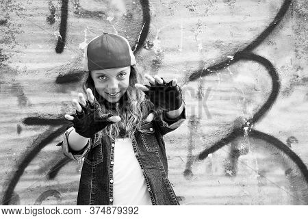 Nice Girl, Teenager, In A Baseball Cap Extended Her Arms Forward, Against The Background Of A Vintag