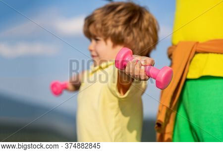 Sporty Boy With Dumbbells. Sport. Fitness, Health And Energy. Cheerful Boy Do Exercises With Dumbbel