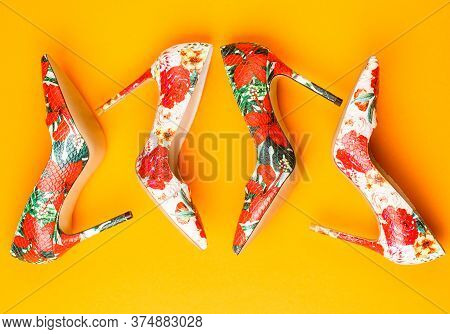 Fashionable Women Shoes. Colored Women Shoes On Yellow, Orange Background. Colorful Leather Shoes St