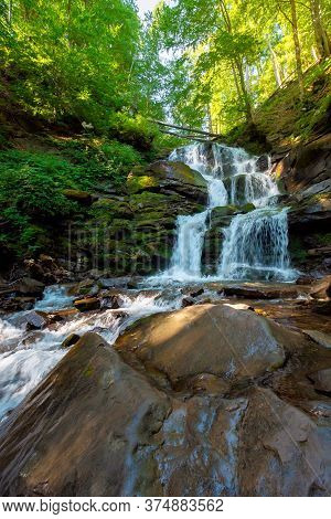 Great Water Fall In The Forest. Beautiful Nature Landscape. River Among The Rocks. Fresh Summer Scen