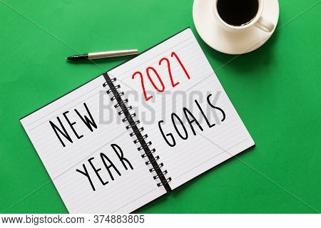 Flat Lay Of Notebook With Words Written - New Year Resolution, 2021 Goals. Green Background, New Yea
