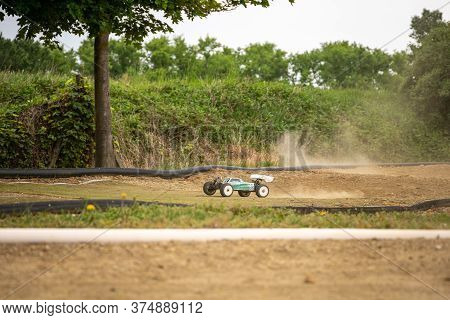 Offroad Rc Buggy Driving On An Outdoor Dirt Track