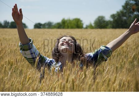 Beauty Girl Enjoying Outdoor. Outstretched Arms Fresh Morning Air Summer At Sunrise. Unity Of Human