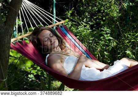 Beautiful Woman Sleep In Hammock. Summer Holiday And Vacation. Sexy Girl Relax In Hammock. Female We